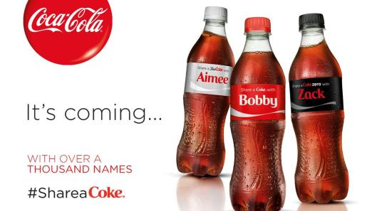 "An advertisement for ""Share a Coke"" shows three Coke bottles with different first names on them."