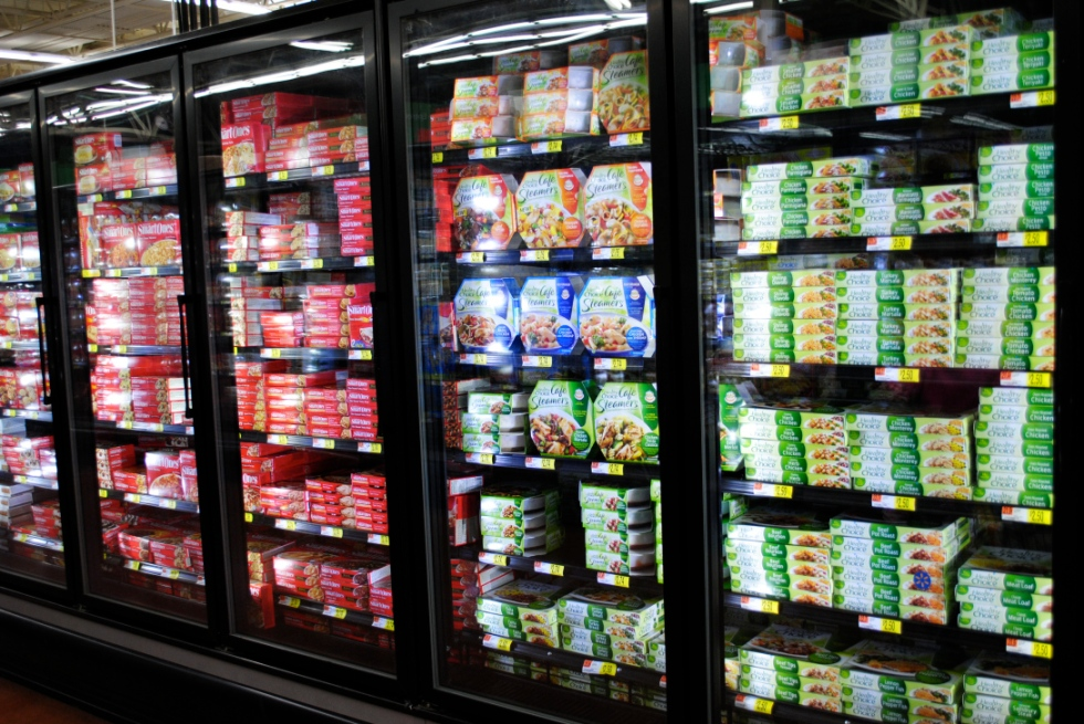 A frozen food aisle in the grocery store.