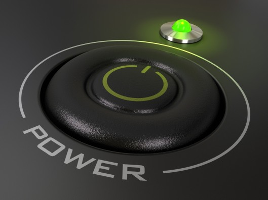 A power button with a green light turned on next to it.