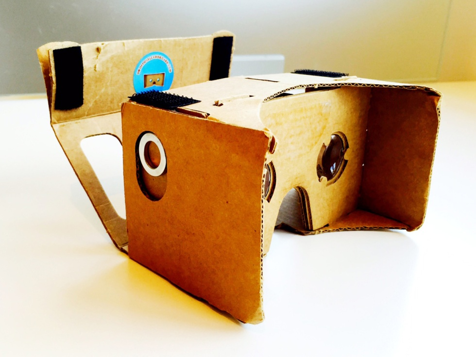 A headset made out of cardboard with a place to insert your phone.