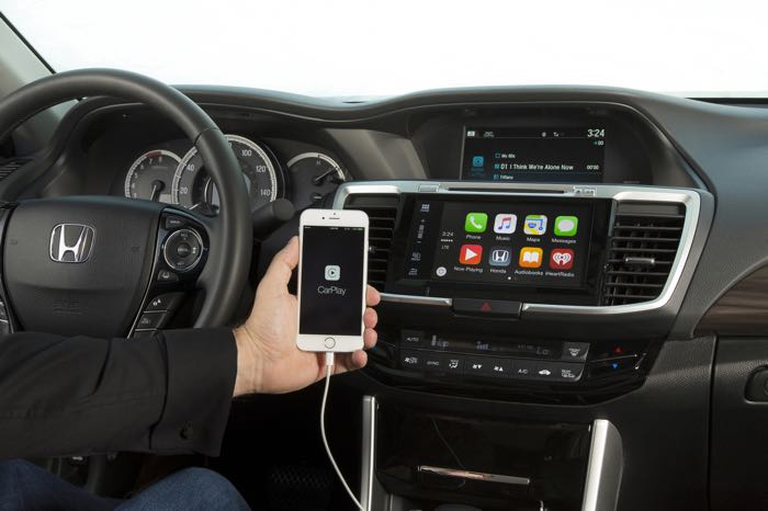 An IPhone connected to the dashboard inside of a new 2016 Honda Accord.