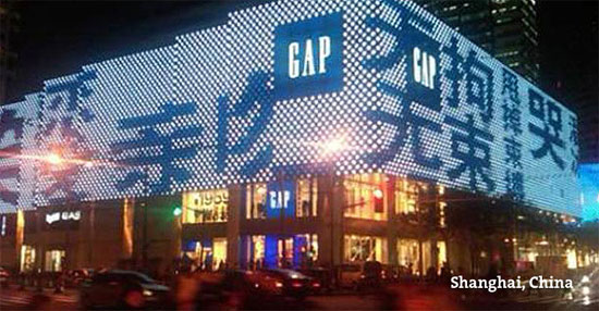 A city corner in Shanghai, China with a digital GAP billboard.