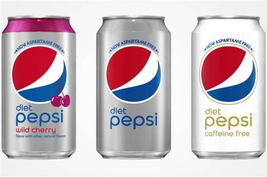"Three cans of diet Pepsi containing the words ""Now Aspartame Free."""