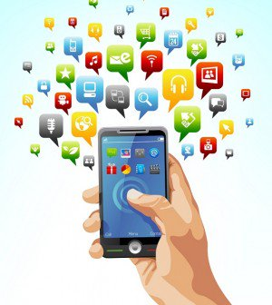 A hand holding a mobile phone with apps surrounding the phone.